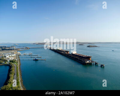 Aerial of bulk carrier ships being loaded with export coal from the RG Tanna Coal Terminal at Gladstone Queensland Australia - Stock Photo