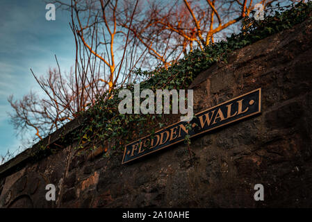 Flodden wall sign, a part of the historic old defensive wall surrounding Edinburgh, covered with plants that grow by the time goes by. - Stock Photo