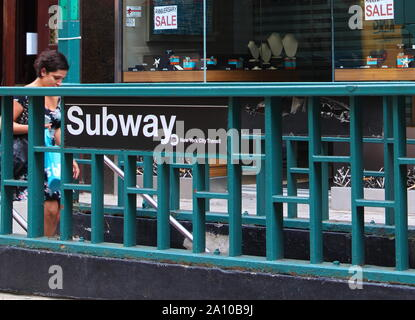 New York, NY USA. Aug 2015. The signs, yellow taxicabs, attractions, traffic, and just getting around experiencing The Big Apple. - Stock Photo
