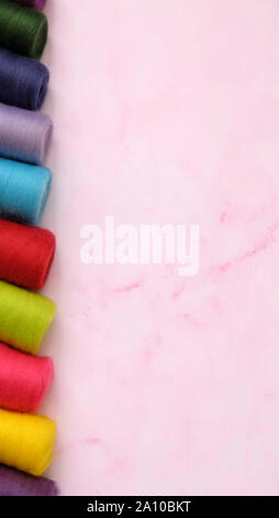 Colorful wool felt rolls in a row, with large empty space on the right. - Stock Photo