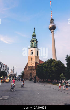 Fernsehturm Television Tower and st. Mary's Church - Stock Photo