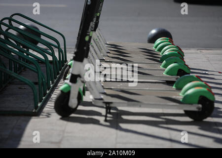 Bucharest, Romania - September 22, 2019: Lime electric scooters one next to another in downtown bucharest. - Stock Photo