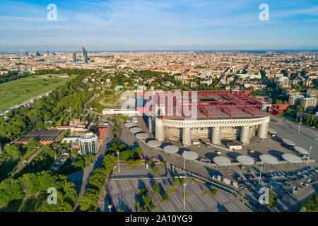 Milan cityscape and the soccer arena Meazza stadium, also known as San Siro Stadium. Aerial panoramic view. - Stock Photo