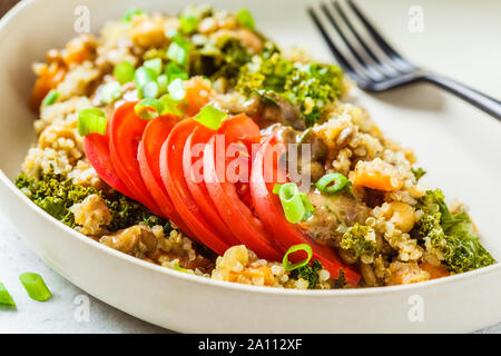 Vegan stew with chickpeas, sweet potato and fresh tomato on a white plate. Vegetarian lunch dish. - Stock Photo