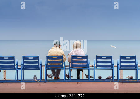 Happy life and long lived concept. Handsome old man and beautiful old woman sitting together Stock Photo