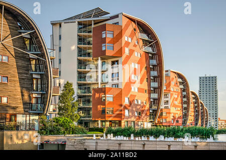 Den Bosch, The Netherlands, September 20, 2019: row of residential buildings in the Palace Quarter, one with wooden facade, the others brick, with a r - Stock Photo