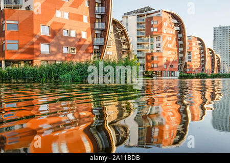 Den Bosch, The Netherlands, September 20, 2019: row of residential buildings in the Palacae Quarter, with spectacular sailboat-inspired design, reflec - Stock Photo