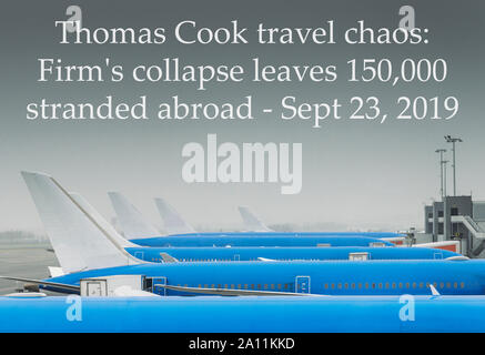 London, UK - Sept 23, 2019: Airplanes parked in rows at airport with caption of Thomas Cook travel chaos: firm's collapse leaves 150,000 stranded - Stock Photo
