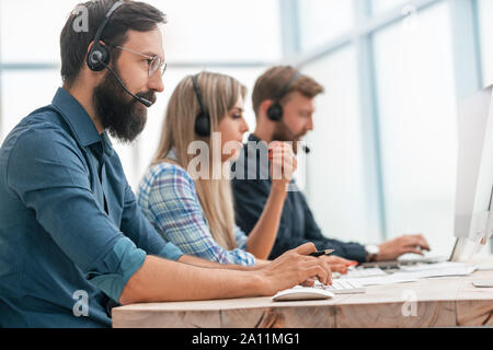 close up. call center operators work in a modern office. - Stock Photo