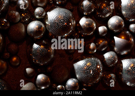 Silver disco balls composition glittering with golden lights Stock Photo