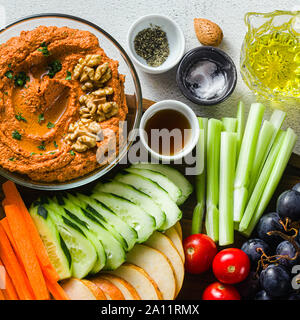 dip or spread of roasted red pepper and nuts. healthy vegan food for celebration or party . shot from above. copy space - Stock Photo