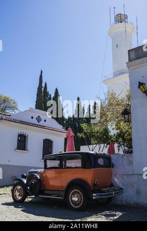 Obsolete car, in front of the lighthouse of Colonia del Sacramento, Uruguay. It is one of the oldest cities in Uruguay. World Heritage by UNESCO in 19 - Stock Photo