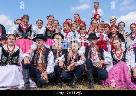 Slavuta, Ukraine - september 22, 2019 : Ukrainian girls and boys in national costumes take part in the Ethno-eco festival Kolodar in city Slavuta, Ukr - Stock Photo