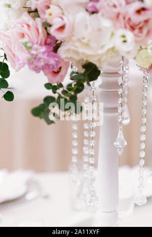 The lens chains complement the flower composition on the wedding table - Stock Photo