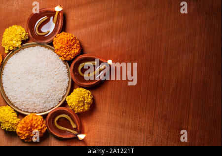 Happy Diwali - Diya oil lamp lit during Indian festive season of Diwali with copy space. Top view background concept for Diwali, deepawali. - Stock Photo