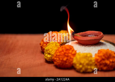Diwali Diya, oil lamp beautifully decorated on the festive occasion of deepavali, deepawali. Beautiful stock photo with copy space of diwali diya - Stock Photo