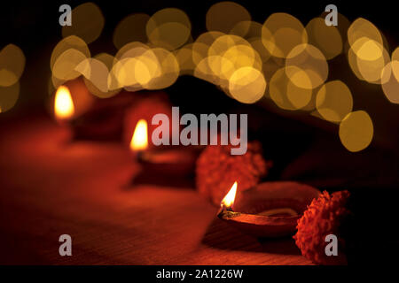 Clay diya or traditional oil lamp lit during Diwali celebration. Background and greetings card concept for Indian hindu festival, Deepawali, deepavali - Stock Photo
