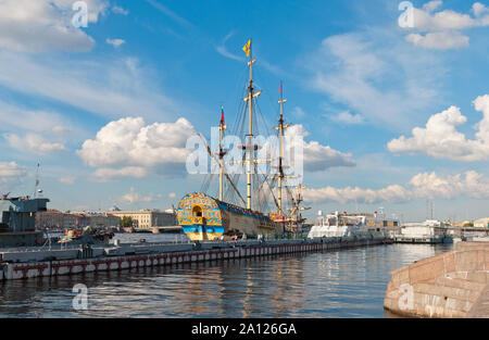 Saint-Petersburg, Russia–July 7, 2019: People on excursion near Russian ship of the line Poltava built in 1712. Recreated model is a museum complex - Stock Photo