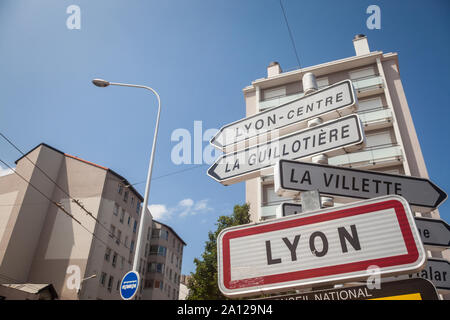 LYON, FRANCE - JULY 15, 2019: Roadsign indicating the entrance to Lyon. This sign is a standard French plate visible at every entrance to any municipa - Stock Photo