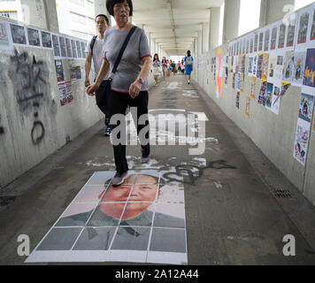 Pro democracy and anti extradition law protests slogans and posters in Hong Kong. 23 September 2019. Pedestrian bridge at Kowloon Tong station covered in pro democracy posters  and graffiti against extradition law proposed by Government. Many anti China posters and messages. - Stock Photo