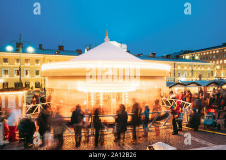 Helsinki, Finland - December 11, 2016: Christmas Xmas Holiday Carousel On Senate Square At Winter Evening. - Stock Photo
