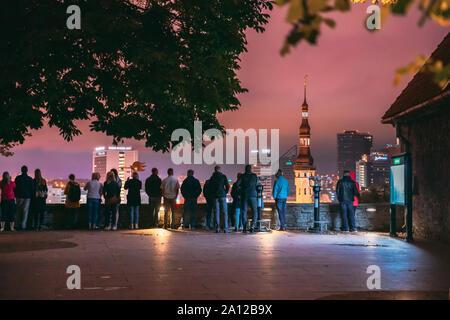 Tallinn, Estonia - July 2, 2019: People Visiting Kohtuotsa Viewing Platform. Cityscape Skyline At Summer Night. View From Patkuli Viewpoint. - Stock Photo
