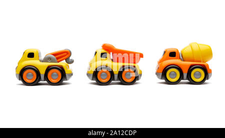 A convoy of toy trucks isolated and shot on a white background - Stock Photo