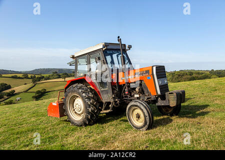Tractor, Modern, Agriculture, Red, Retail, Agricultural Equipment, Agricultural Field, Agricultural Machinery, Business, Color Image, Commercial Land - Stock Photo