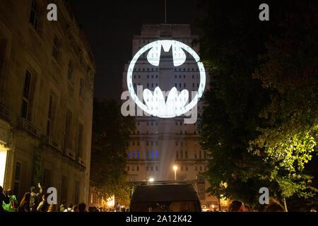 London UK. 21 September 2019. Gotham City iconic bat signal shines on Senate House London Bloomsbury marking batmanday global celebrations of Batman - Stock Photo