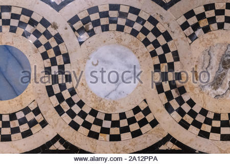 Antique marble floor with a pattern of circles and curves. Beautiful vintage architecture made with valuable stones - Stock Photo