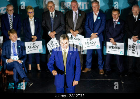 Party leader Nigel Farage speaks in front of prospective Brexit Party MPs during the Brexit Party conference in Newport, Wales, September 2019. - Stock Photo