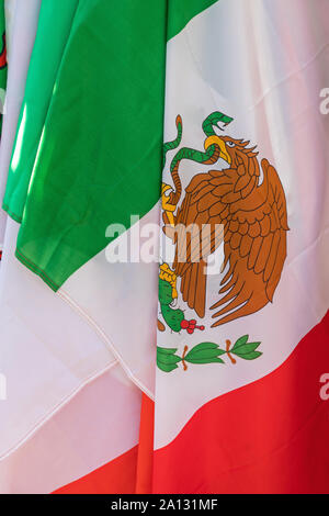 Mexico Eagle Coat of Arms at Mexican Flag - Stock Photo