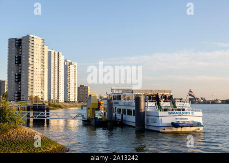 Party boat on the river Maas in the city centre of Rotterdam waiting to depart at sunset - Stock Photo