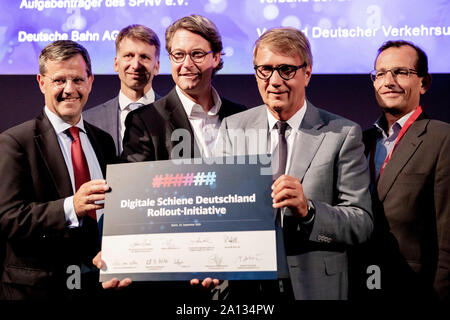 23 September 2019, Berlin: Christoph Hoppe (l-r), member of the Executive Committee of the German Railway Industry Association (VDB), Martin Schmitz, Managing Director Technology of the German Transport Association (VDV), Andreas Scheuer (CSU), Federal Minister of Transport, Ronald Pofalla, Member of the Board of Directors Infrastructure of Deutsche Bahn AG, and Christian Schreyer, Chairman of the Supervisory Board of Transdev GmbH, will take part in the 'Digital Rail Summit I Forum Digital Rail Germany 2019' with the symbolically signed 'Digital Rail Germany Rollout Initiative' for a photo. P - Stock Photo