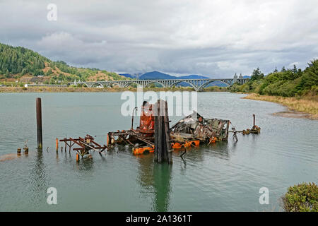 The wreck of the old steam boat Mary D Hume, at the mouth of the Rogue River, in Gold Beach Oregon, on the Oregon Pacific Coast - Stock Photo