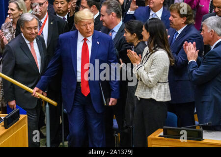 New York, USA,  23 September 2019.  New York City.   US President Donald Trump is applauded as he arrives at the 'Global Call to Protect Religious Freedom' event at U.N. headquarters in New York City along with UN Secretary-General António Guterres (L). Credit: Enrique Shore/Alamy Live News - Stock Photo