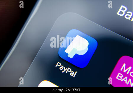 PayPal app seen on the edge of smartphone screen in a group with other banking apps as M&S Bank. Close up photo with shallow depth of field. - Stock Photo