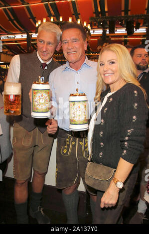Siegfried Able, Arnold Schwarzenegger and his girlfriend Heather Milligan during the Oktoberfest 2019 at Theresienwiese on September 22, 2019 in Munich, Germany - Stock Photo