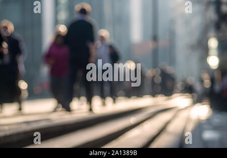 Defocused image of people walking along a street in the center of London, England, UK - Stock Photo
