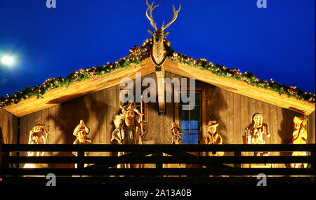 Nativity scene on a wooden house at the Christmas market .. - Stock Photo
