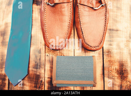 Stylish leather shoes on wooden background. Groom ready for wedding. Menswear and accessories. Matching wallet and necktie. Fashion and style. Male outfit fashion accessories. Accessories shop. - Stock Photo