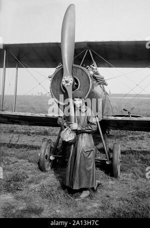 American aviator Katherine Stinson in front of her biplane.