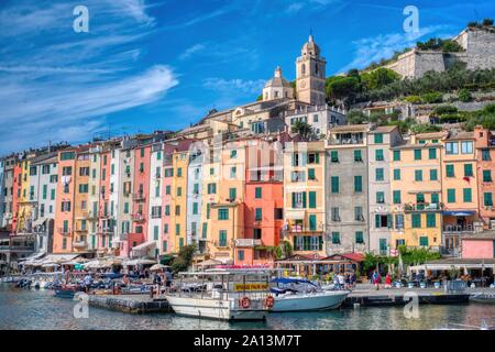 Portovenere, Italy- September 19, 2018: View of the city in the Ligurian sea of the ancient and typical Cinque Terre village in summer - Stock Photo