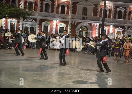 Dancing the marinera in the Plaza de Armas in Trujillo, Peru - Stock Photo