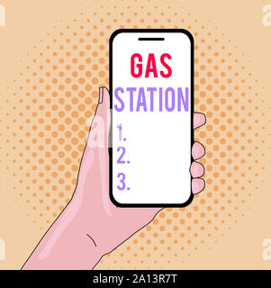 Writing note showing Gas Station. Business concept for for servicing motor vehicles especially with gasoline and oil Closeup of Smartphone Device Held - Stock Photo