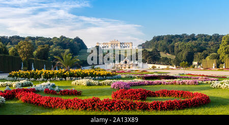 Vienna, Austria - September 3, 2019: View on Schonbrunn Palace and garden with colorful flowers in Vienna, Austria - Stock Photo