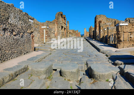 Street and ruins of houses in the ancient Roman city of Pompeii, Italy - Stock Photo