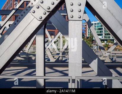 Shoot of silver colored steel construction of a bridge at day. Focus on foreground. - Stock Photo