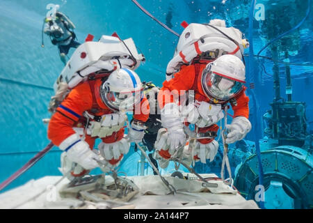 Cosmonaut training in the pool, in spacesuits. Elements of this image were furnished by NASA - Stock Photo