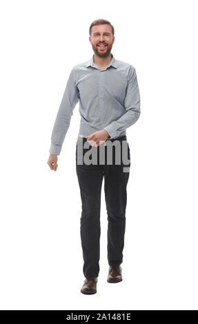 in full growth. smiling business man confidently steps forward - Stock Photo